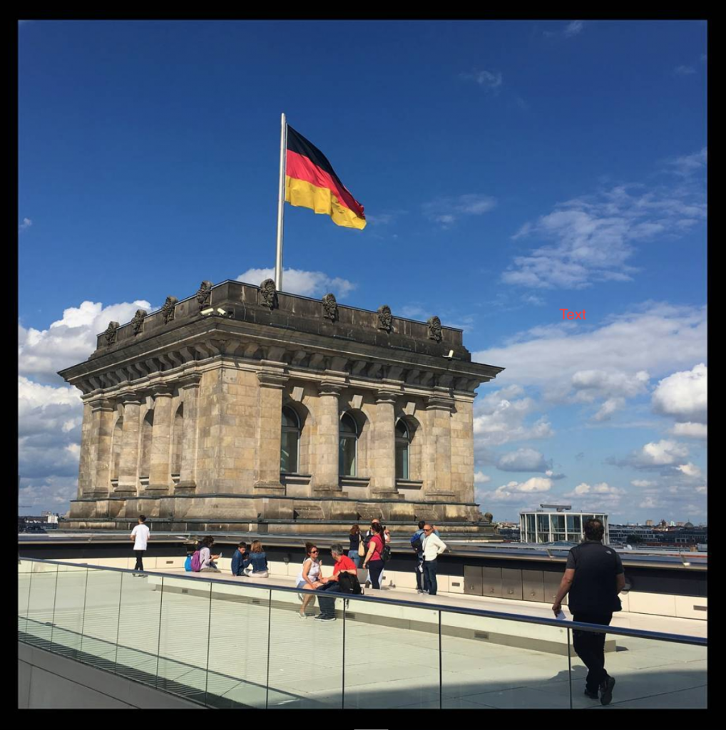 Standing above the Reichstag